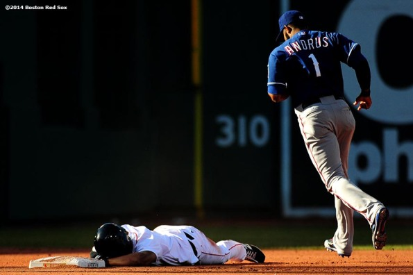"""Boston Red Sox shortstop Xander Bogaerts reacts after being tagged out by shortstop Elvis Andrus as he attempts to steal second base during the fourth inning of a game against the Texas Rangers at Fenway Park in Boston, Massachusetts Wednesday, April 9, 2014."""