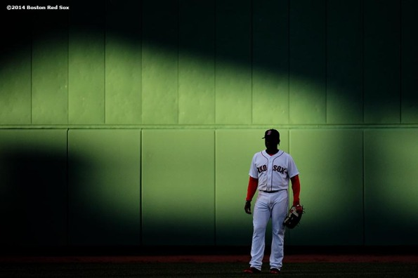 """Boston Red Sox center fielder Jackie Bradley Jr. stands in center field during the sixth inning of a game against the Texas Rangers at Fenway Park in Boston, Massachusetts Wednesday, April 9, 2014."""