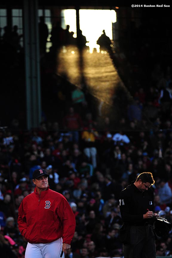 """Boston Red Sox manager John Farrell walks off the field after speaking with an umpire during the sixth inning of a game against the Texas Rangers at Fenway Park in Boston, Massachusetts Wednesday, April 9, 2014."""