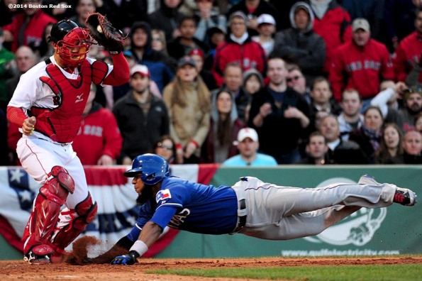 """Boston Red Sox catcher David Ross attempts to tag out shortstop Elvis Andrus during the eighth inning of a game against the Texas Rangers at Fenway Park in Boston, Massachusetts Wednesday, April 9, 2014."""