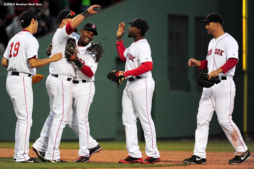 """""""Boston Red Sox infielder Jonathan Herrera reacts after the Red Sox defeated the Texas Rangers at Fenway Park in Boston, Massachusetts Wednesday, April 9, 2014."""""""