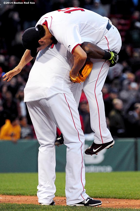 """Boston Red Sox designated hitter David Ortiz picks up pitcher Koji Uehara after the Red Sox defeated the Texas Rangers at Fenway Park in Boston, Massachusetts Wednesday, April 9, 2014."""