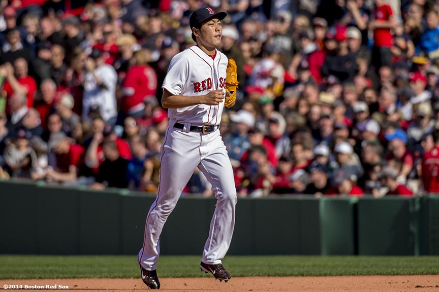 """Boston Red Sox pitcher Koji Uehara jogs toward the mound during the ninth inning of a game against the Baltimore Orioles Saturday, April 19, 2014 at Fenway Park in Boston, Massachusetts."""