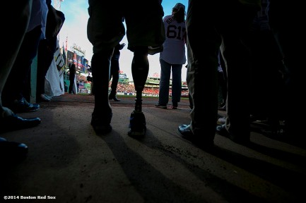 """Boston Marathon survivor Marc Fucarile prepares to enter the field during a ceremony recognizing the Boston Marathon bombings before a game between the Boston Red Sox and the Baltimore Orioles Sunday, April 20, 2014 at Fenway Park in Boston, Massachusetts."""