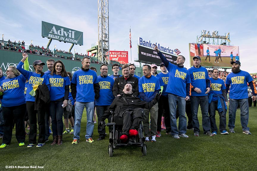 """Boston Marathon running duo Dick and Rick Hoyt are introduced alongside runners injured last year during a ceremony recognizing the Boston Marathon bombings before a game between the Boston Red Sox and the Baltimore Orioles Sunday, April 20, 2014 at Fenway Park in Boston, Massachusetts."""