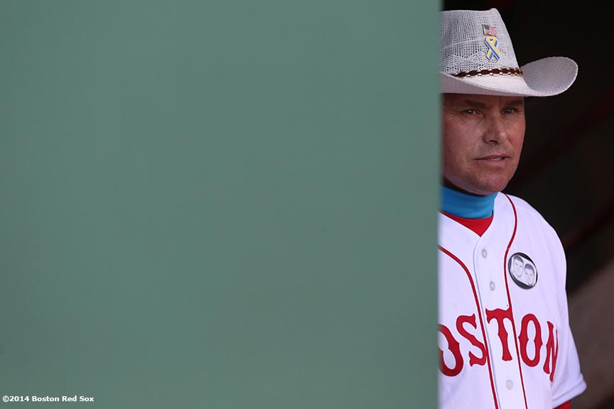 """Boston Marathon rescuer Carlos Arredondo waits to be introduced during a ceremony recognizing the Boston Marathon bombings before a game between the Boston Red Sox and the Baltimore Orioles Sunday, April 20, 2014 at Fenway Park in Boston, Massachusetts."""
