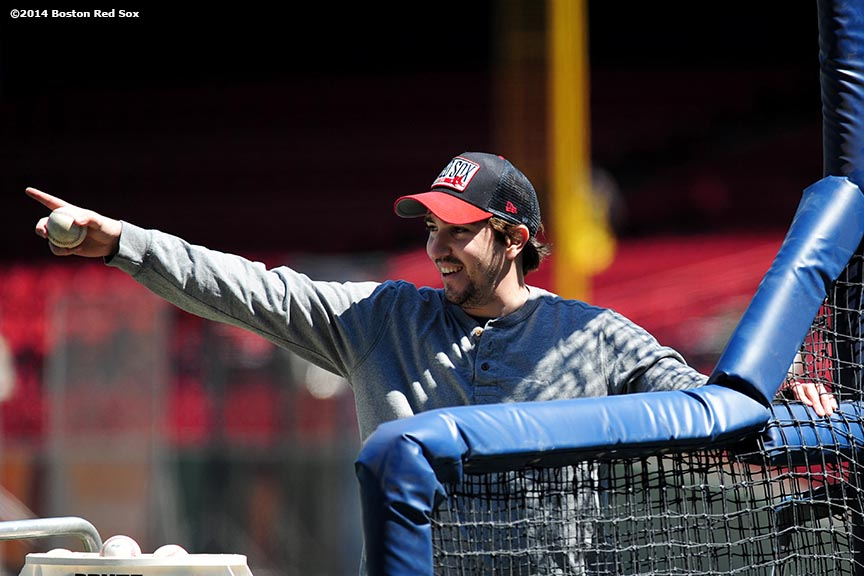 """Boston Marathon bombing survivor Jeff Bauman reacts as he throws batting practice to Boston Red Sox catcher David Ross and outfielder Jonny Gomes at Fenway Park in Boston, Massachusetts Sunday, April 20, 2014."""