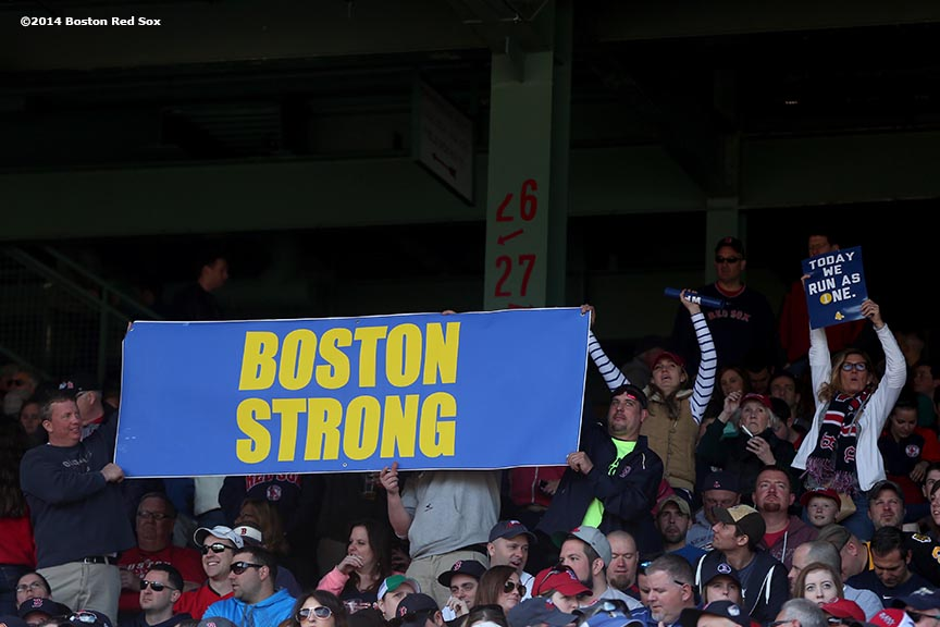 """Fans hold a sign reading 'Boston Strong' during a game between the Boston Red Sox and the Baltimore Orioles at Fenway Park in Boston, Massachusetts Monday, April 21, 2014."""