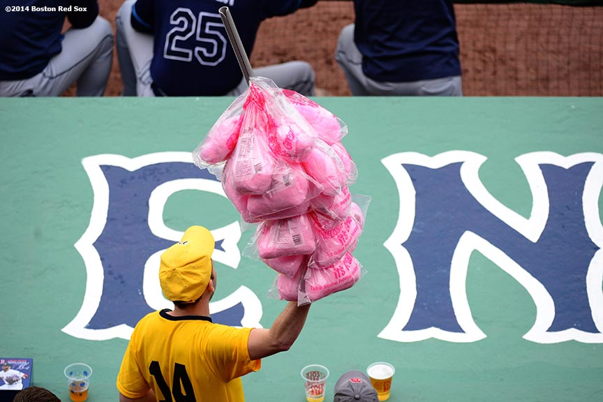 """A vendor sells cotton candy during the first game of a day-night double header between the Boston Red Sox and the Tampa Bay Rays Thursday, May 1, 2014 at Fenway Park in Boston, Massachusetts."""