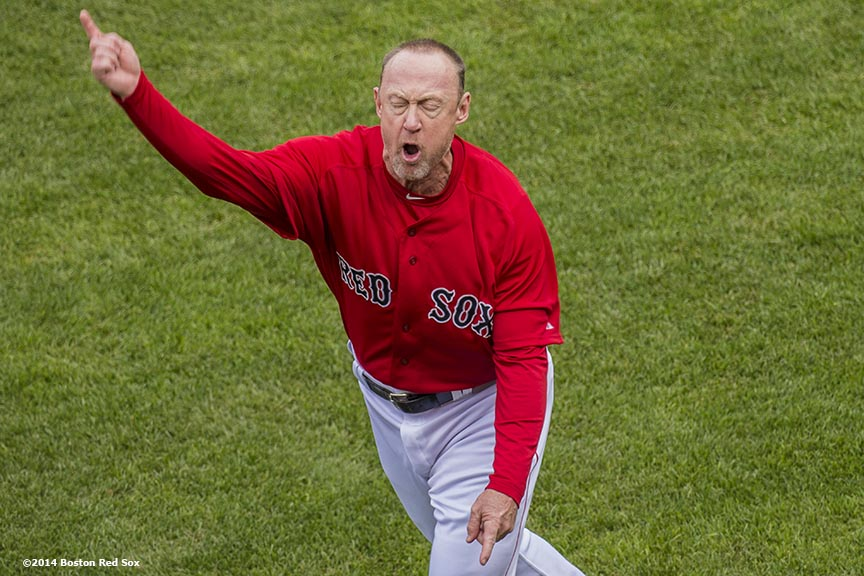 """Boston Red Sox third base coach Brian Butterfield argues a call and is ejected from the game after Dustin Pedroia was called out while attempting to score on a double by designated hitter David Ortiz during the seventh inning of the first game of a day-night double header against the Tampa Bay Rays Thursday, May 1, 2014 at Fenway Park in Boston, Massachusetts. The controversial call stood after being reviewed."""