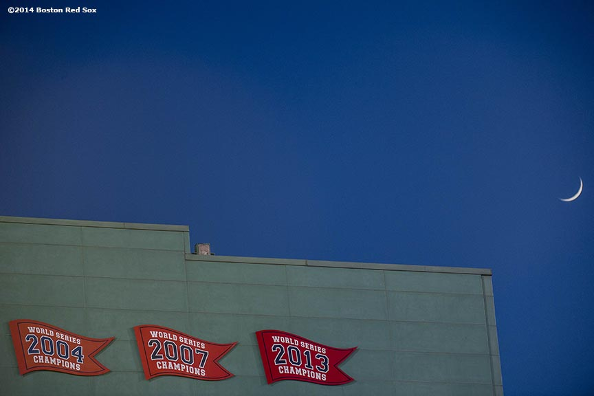 """The moon is shown behind the Fenway Park press box during the second game of a day-night double header between the Boston Red Sox and the Tampa Bay Rays Thursday, May 2, 2014 at Fenway Park in Boston, Massachusetts."""