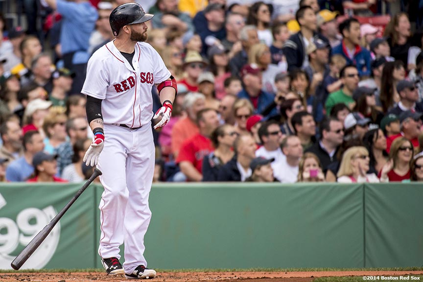"""Boston Red Sox left fielder Jonny Gomes hits a grand slam home run during the first inning of a game against the Oakland Athletics Saturday, May 4, 2014 at Fenway Park in Boston, Massachusetts."""