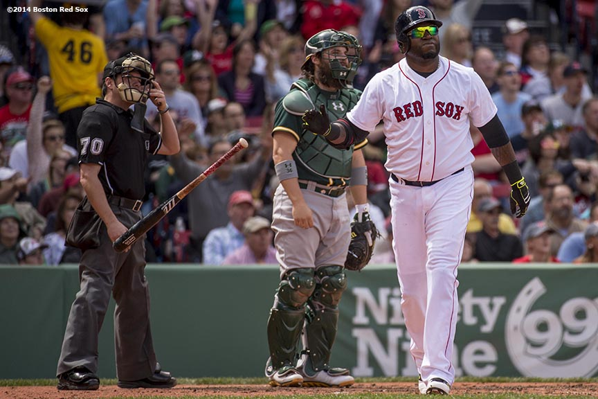 """Boston Red Sox designated hitter David Ortiz hits a solo home run during the third inning of a game against the Oakland Athletics Saturday, May 4, 2014 at Fenway Park in Boston, Massachusetts."""