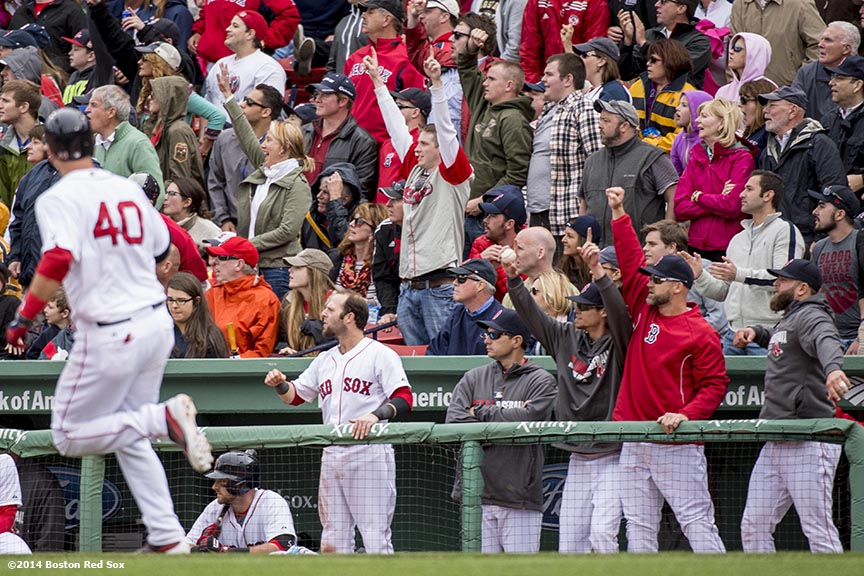 """Boston Red Sox players celebrate as catcher A.J. Pierzynski hits a solo home run during the seventh inning of a game against the Oakland Athletics Sunday, May 5, 2014 at Fenway Park in Boston, Massachusetts."""