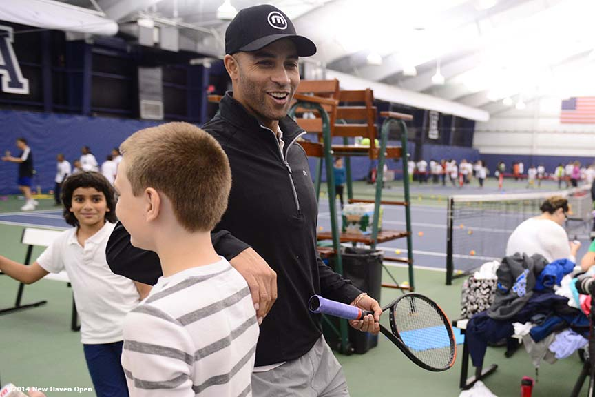 """Former professional tennis player James Blake leads a drill during a free tennis lesson and clinic Thursday, May 15, 2014 in advance of the 2014 New Haven Open at the Yale University Tennis Center in New Haven, Connecticut. """