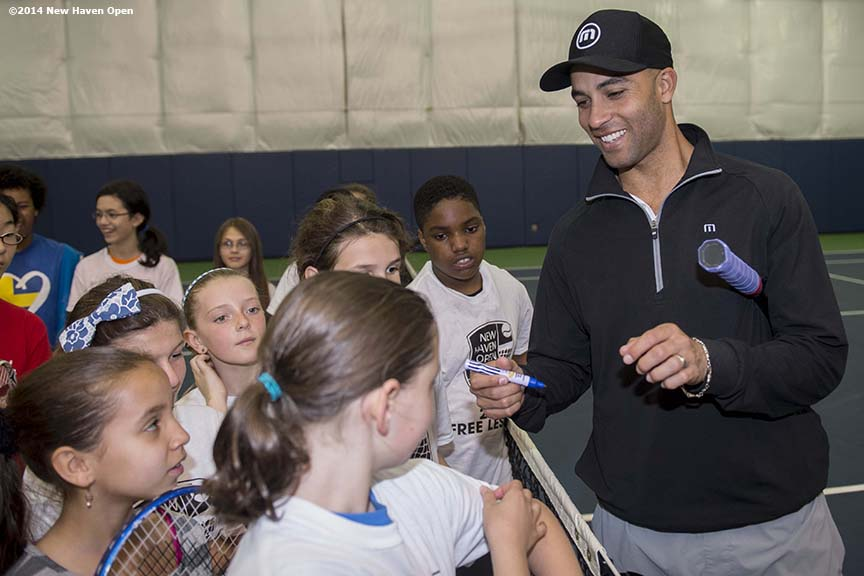"""Former professional tennis player James Blake signs autographs during a free tennis lesson and clinic Thursday, May 15, 2014 in advance of the 2014 New Haven Open at the Yale University Tennis Center in New Haven, Connecticut."""