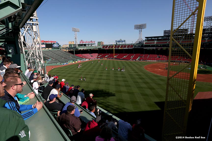 """Fans watch batting practice in the Green Monster seats before a game between the Boston Red Sox and the Detroit Tigers at Fenway Park in Boston, Massachusetts Saturday, May 17, 2014."""