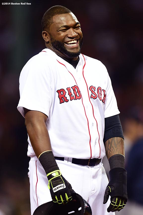 """Boston Red Sox designated hitter David Ortiz laughs during a mound visit during the fourth inning of a game against the Detroit Tigers at Fenway Park in Boston, Massachusetts Saturday, May 17, 2014."""