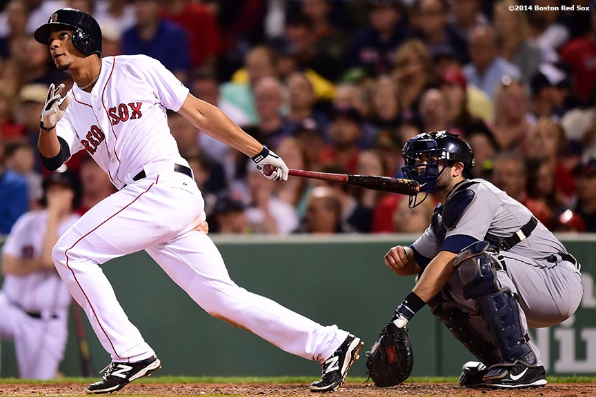 """Boston Red Sox shortstop Xander Bogaerts hits a solo home run during the fifth inning of a game against the Detroit Tigers at Fenway Park in Boston, Massachusetts Saturday, May 17, 2014."""