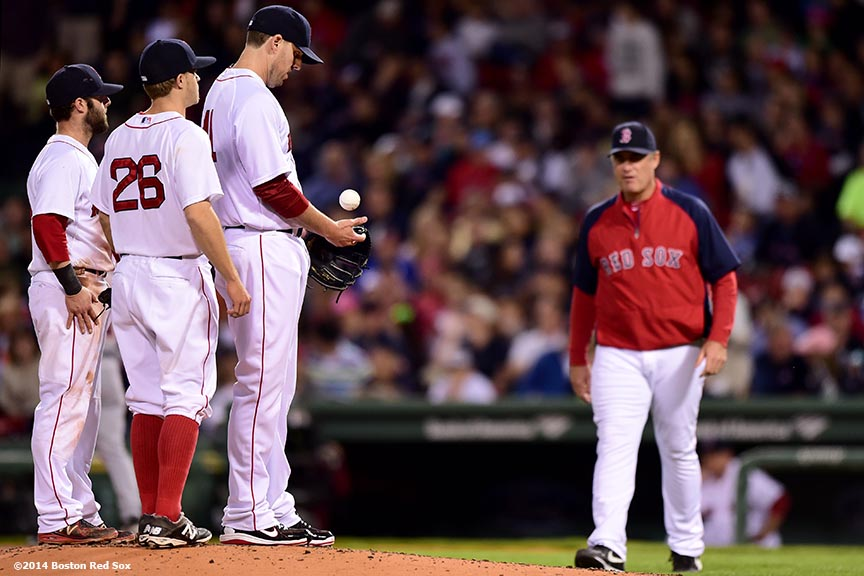 """""""Boston Red Sox pitcher John Lackey tosses the ball as he is taken out of the game during the sixth inning of a game against the Detroit Tigers at Fenway Park in Boston, Massachusetts Saturday, May 17, 2014."""""""