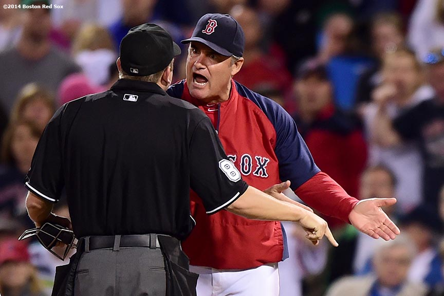 """Boston Red Sox manager John Farrell argues with the home plate umpire after right fielder Shane Victorino was called for interference while running out a ground ball during the eighth inning of a game against the Detroit Tigers at Fenway Park in Boston, Massachusetts Saturday, May 17, 2014."""