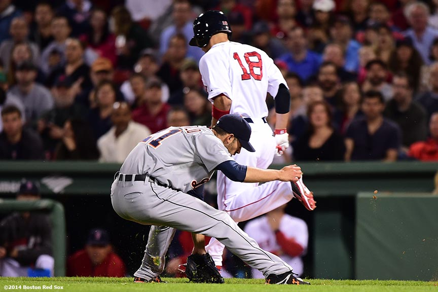 """Boston Red Sox right fielder Shane Victorino avoids a tag from pitcher Rick Porcello during the eighth inning of a game against the Detroit Tigers at Fenway Park in Boston, Massachusetts Saturday, May 17, 2014."""