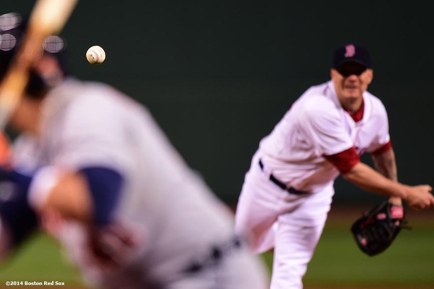 """Boston Red Sox pitcher Jake Peavy delivers during the first inning of a game against the Detroit Tigers at Fenway Park in Boston, Massachusetts Sunday, May 18, 2014."""
