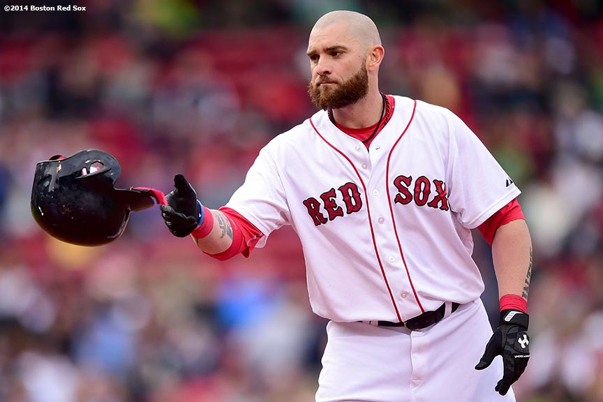 """Boston Red Sox left fielder Jonny Gomes tosses his helmet during the third inning of a game against the Toronto Blue Jays Thursday, May 22, 2014 at Fenway Park in Boston, Massachusetts."""