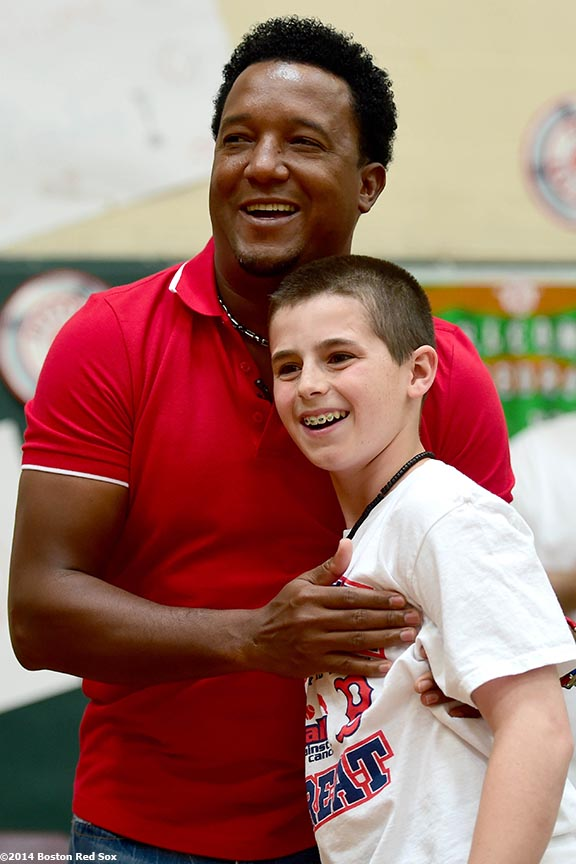 """Former Boston Red Sox pitcher Pedro Martinez hugs a student during a visit to Furnace Brook Middle School in Marshfield, Massachusetts Tuesday, May 27, 2014 as part of the Rally Against Cancer Program, a collaborative effort between the Red Sox and the Jimmy Fund to raise money for cancer research and care."""
