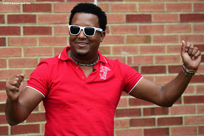 """Former Boston Red Sox pitcher Pedro Martinez wears sunglasses as he dances during a visit to Furnace Brook Middle School in Marshfield, Massachusetts Tuesday, May 27, 2014 as part of the Rally Against Cancer Program, a collaborative effort between the Red Sox and the Jimmy Fund to raise money for cancer research and care."""