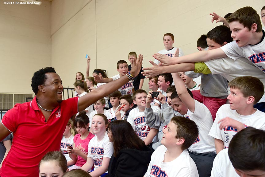 """Former Boston Red Sox pitcher Pedro Martinez high fives students during a visit to Furnace Brook Middle School in Marshfield, Massachusetts Tuesday, May 27, 2014 as part of the Rally Against Cancer Program, a collaborative effort between the Red Sox and the Jimmy Fund to raise money for cancer research and care."""