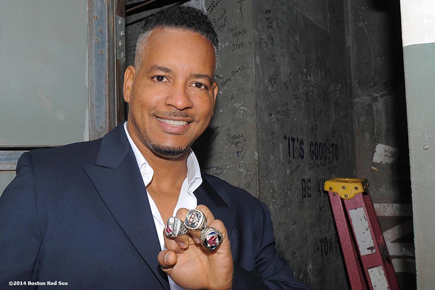 """Former Boston Red Sox outfielder Manny Ramirez poses with the 2004, 2007, and 2013 World Series rings during the 2004 team reunion at Fenway Park in Boston, Massachusetts Wednesday, May 28, 2014."""