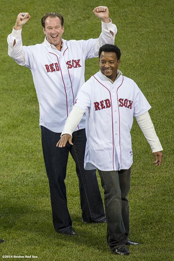 """Former Boston Red Sox pitchers Derek Lowe and Pedro Martinez are introduced during a pre-game ceremony honoring the ten year anniversary and team reunion of the 2004 World Series champion Boston Red Sox at Fenway Park in Boston, Massachusetts Wednesday, May 28, 2014."""