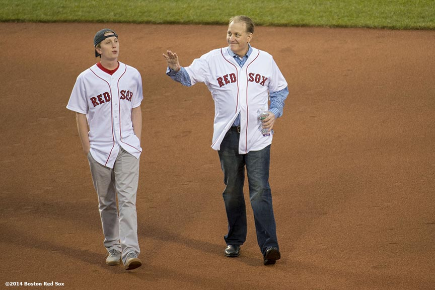 """Former Boston Red Sox pitcher Curt Schilling and son Gehrig are introduced during a pre-game ceremony honoring the ten year anniversary and team reunion of the 2004 World Series champion Boston Red Sox at Fenway Park in Boston, Massachusetts Wednesday, May 28, 2014."""