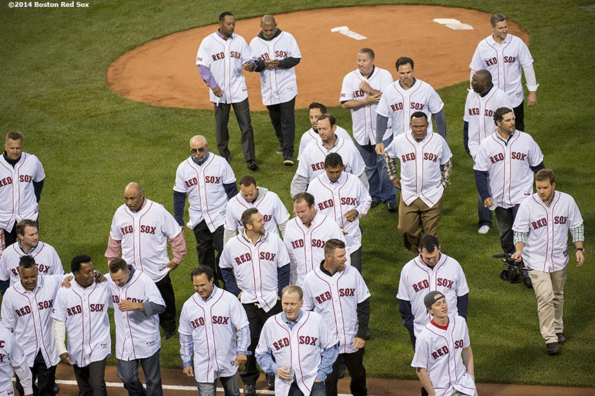 """Former Boston Red Sox players walk off the field after being introduced during a pre-game ceremony honoring the ten year anniversary and team reunion of the 2004 World Series champion Boston Red Sox at Fenway Park in Boston, Massachusetts Wednesday, May 28, 2014."""