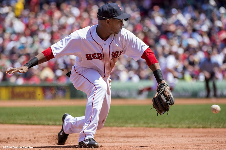 """Boston Red Sox third baseman Jonathan Herrera fields a ground ball during the second inning of a game against the Tampa Bay Rays at Fenway Park in Boston, Massachusetts Sunday, June 1, 2014."""