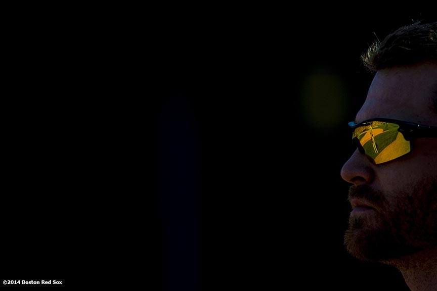 """A reflection is shown in the sunglasses of Tampa Bay Rays second baseman Logan Forsythe during the singing of 'God Bless America' in the seventh inning of a game against the Boston Red Sox at Fenway Park in Boston, Massachusetts Sunday, June 1, 2014."""
