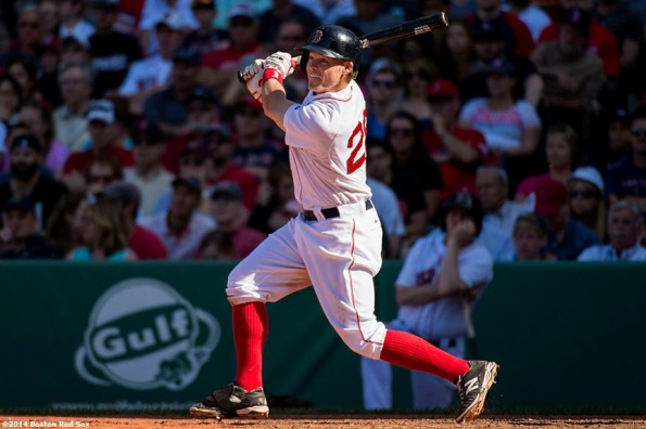"""""""Boston Red Sox first baseman Brock Holt hits a double during the ninth inning of a game against the Tampa Bay Rays at Fenway Park in Boston, Massachusetts Sunday, June 1, 2014."""""""