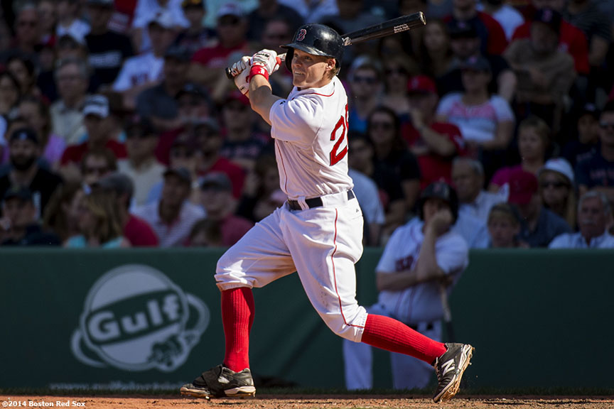 """Boston Red Sox first baseman Brock Holt hits a double during the ninth inning of a game against the Tampa Bay Rays at Fenway Park in Boston, Massachusetts Sunday, June 1, 2014."""