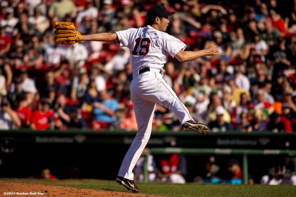 """""""Boston Red Sox pitcher Koji Uehara delivers during the ninth inning of a game against the Tampa Bay Rays at Fenway Park in Boston, Massachusetts Sunday, June 1, 2014."""""""