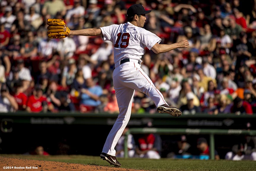 """Boston Red Sox pitcher Koji Uehara delivers during the ninth inning of a game against the Tampa Bay Rays at Fenway Park in Boston, Massachusetts Sunday, June 1, 2014."""