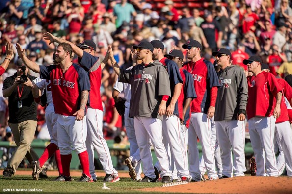 """""""Boston Red Sox teammates line up to high five each other after defeating the Tampa Bay Rays at Fenway Park in Boston, Massachusetts Sunday, June 1, 2014."""""""