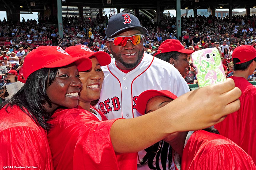 """Boston Red Sox designated hitter David Ortiz takes a selfie with  members of the 2014 graduating class of Red Sox Scholars during a pre-game at Fenway Park in Boston, Massachusetts Sunday, June 1, 2014."""