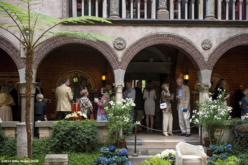 """Guests attend a cocktail reception during the Friends of Fenway Court Patron event at the Isabella Stewart Gardner Museum in Boston, Massachusetts Wednesday, June 4, 2014."""