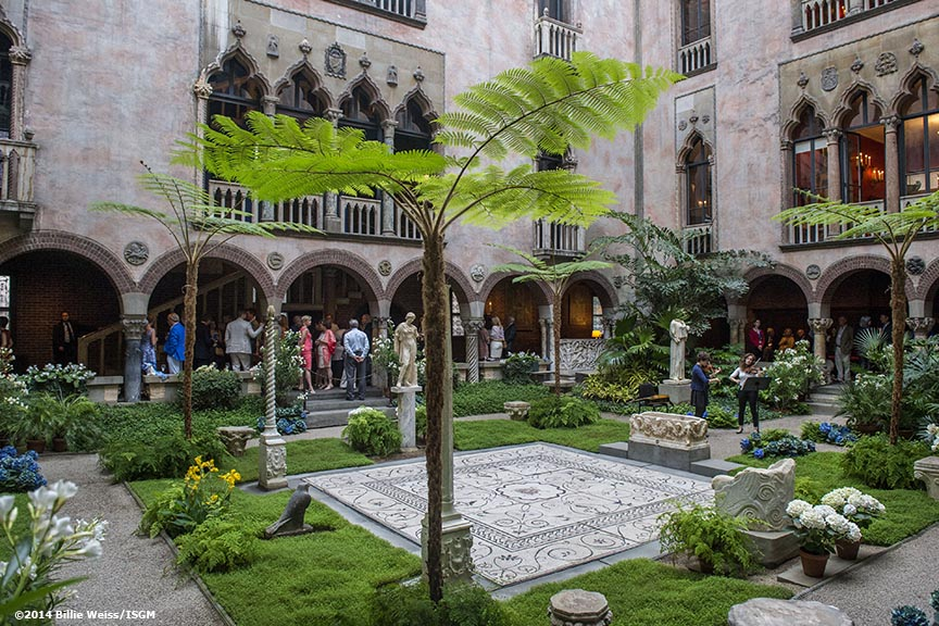 Guests attend a cocktail reception during the Friends of Fenway Court Patron event at the Isabella Stewart Gardner Museum in Boston, Massachusetts Wednesday, June 4, 2014.
