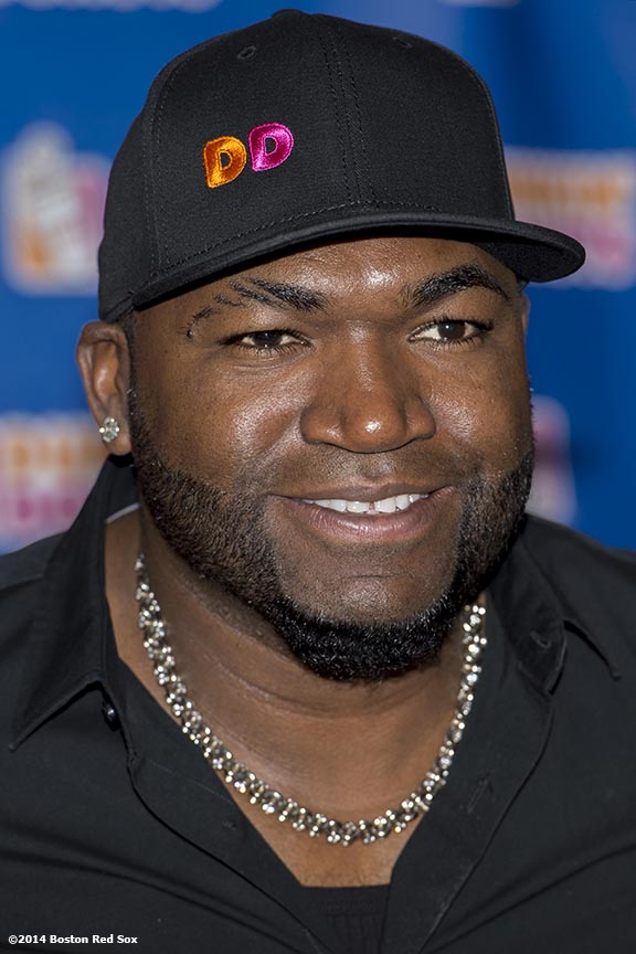 """Boston Red Sox designated hitter David Ortiz poses for a photograph with fans during the Dunkin' Donuts ""Papi's Day"" lunch in the State Street Pavilion at Fenway Park in Boston, Massachusetts Friday, June 13, 2014."""