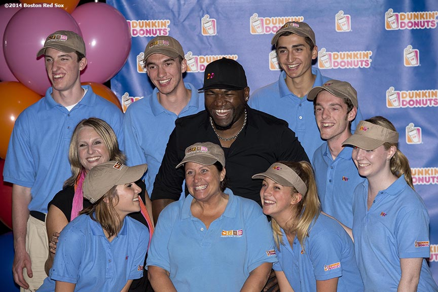 """Boston Red Sox designated hitter David Ortiz poses for a photograph Dunkin' Donuts employees during the Dunkin' Donuts ""Papi's Day"" lunch in the State Street Pavilion at Fenway Park in Boston, Massachusetts Friday, June 13, 2014."""