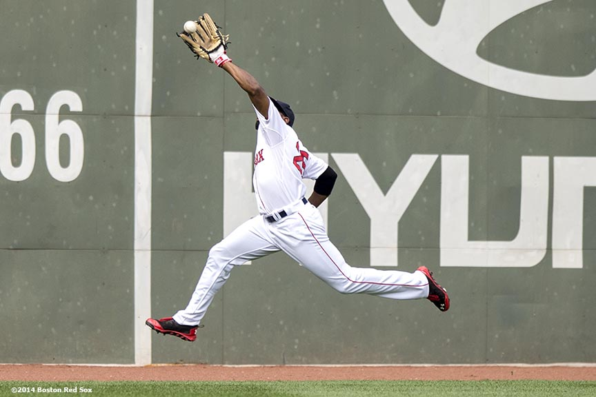 """Boston Red Sox center fielder Jackie Braldey Jr. makes a leaping catch during the first inning of a game against the Cleveland Indians Saturday, June 14, 2014 at Fenway Park in Boston, Massachusetts."""