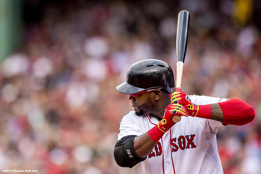 """Boston Red Sox designated hitter David Ortiz bats during the first inning of a game against the Cleveland Indians Saturday, June 14, 2014 at Fenway Park in Boston, Massachusetts."""