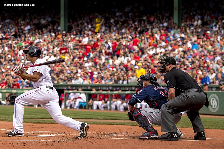 """Boston Red Sox shortstop Xander Bogaerts hits a single during the first inning of a game against the Cleveland Indians Saturday, June 14, 2014 at Fenway Park in Boston, Massachusetts."""
